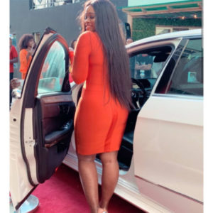 Cee-C posing with her new car